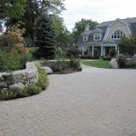 Masonry - stone driveway with meandering stonewall