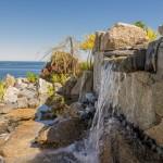 Waterfall built into ocean cliffs
